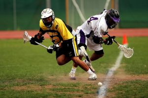 Lacrosse is a team sport played with a lacrosse stick and a lacrosse ball.